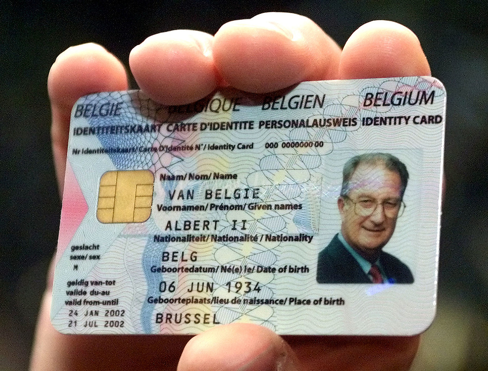 An employee of Belgian Agfa-Gevaert company shows a specimen of the.future European ID card of Belgian King Albert II in Mortsel, near.Antwerp January 24, 2002. King Albert was briefed on new digital.technologies for printing, medical radiography and for securised.electronic ID cards during his visit of the company. REUTERS/Thierry.Roge..THR/CLH/
