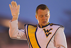 A WVU band director directs the WVU Marching Band during a battle of the bands in downtown Memphis.