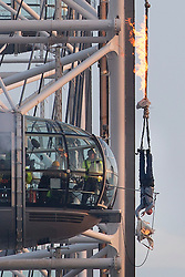 © licensed to London News Pictures. London, UK 05/03/2013 British TV escapologist and daredevil Jonathan Goodwin performs a death defying burning rope trick inspired by Houdini on the London Eye to as part of his new TV show. Photo credit: Tolga Akmen/LNP
