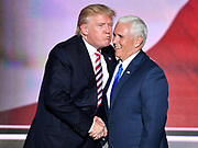 Republican presidential candidate Donald Trump gives his Vice-President choice Mike Pence an air kiss following Pence's acceptance speech at the the Republican National Convention.