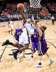 Virginia guard Jeff Jones (1) shoots over Northwestern forward Jean-Marc Melchior (25).  The Virginia Cavaliers men's basketball team defeated the Northwestern Wildcats 94-52 at John Paul Jones Arena in Charlottesville, VA on November 27, 2007.