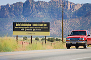 "Sept 8, 2008 -- COLORADO CITY, AZ: A sign sponsored by Childhelp USA on the outskirts of Colorado City, AZ. Polygamist residents of the town are unhappy about the sign, claiming it is intended to encourage their young people to leave home. Colorado City and the neighboring town of Hildale, UT, are home to the Fundamentalist Church of Jesus Christ of Latter Day Saints (FLDS) which split from the mainstream Church of Jesus Christ of Latter Day Saints (Mormons) after the Mormons banned what they call ""Celestial Marriage"" (polygamy) in 1890 so that Utah could gain statehood into the United States. The FLDS Prophet (leader), Warren Jeffs, has been convicted in Utah of ""rape as an accomplice"" for arranging the marriage of teenage girl to her cousin and is currently on trial for similar, those less serious, charges in Arizona. After Texas child protection authorities raided the Yearning for Zion Ranch, (the FLDS compound in Eldorado, TX) many members of the FLDS community in Colorado City/Hildale fear either Arizona or Utah authorities could raid their homes in the same way. Older members of the community still remember the Short Creek Raid of 1953 when Arizona authorities using National Guard troops, raided the community, arresting the men and placing women and children in ""protective"" custody. After two years in foster care, the women and children returned to their homes. After the raid, the FLDS Church eliminated any connection to the ""Short Creek raid"" by renaming their town Colorado City in Arizona and Hildale in Utah. The Jessops are a polygamous family and members of the FLDS.   Photo by Jack Kurtz / ZUMA Press"