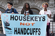 "San Francisco, USA. 19th January, 2019. The Women's March San Francisco begins with a rally at Civic Center Plaza in front of City Hall. Three young people hold a banner on stage reading: ""Housekeys Not Handcuffs,"" as representatives from the Coalition on Homelessness speak about the plight of homeless women in San Francisco. Credit: Shelly Rivoli/Alamy Live News"
