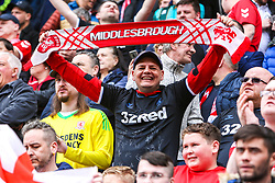 A Middlesbrough fan holds a scarf - Mandatory by-line: Ryan Crockett/JMP - 05/05/2019 - FOOTBALL - Aesseal New York Stadium - Rotherham, England - Rotherham United v Middlesbrough - Sky Bet Championship