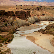 River in souther Morocco with tha Atlas mountains on the background
