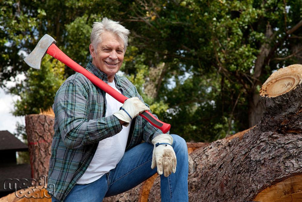 Portrait of lumberjack holding an axe