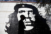 Angolans walk past the Che Guevara mural in the centre of sumbe. Sumbe, Kwanza Sul Province, Angola. Africa. .Pictures © Z & D Lightfoot..www.lightfootphoto.co.uk