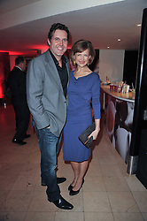 KATIE DERHAM and her husband JOHN VINCENT at the Costa Book Awards 2010 held at Quaglino's, 16 Bury Street, London on 25th January 2011.