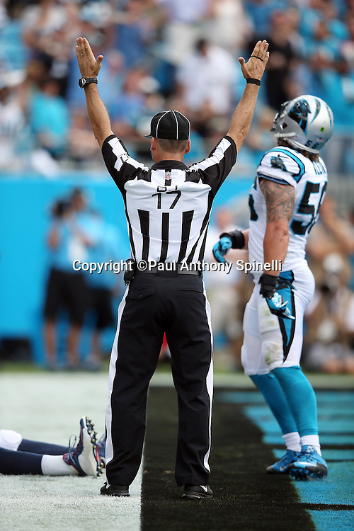 Back judge Steve Patrick (17) signals a Carolina Panthers touchdown during the 2015 NFL week 2 regular season football game against the Houston Texans on Sunday, Sept. 20, 2015 in Charlotte, N.C. The Panthers won the game 24-17. (©Paul Anthony Spinelli)