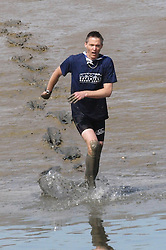 Ashley James comes in to win the Maldon Mud race in Essex, Sunday, 5th May 2013  Photo by :  Max Nash / i-Images