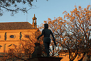 Statue of the architect Andres de Vandelvira, 1509–75, Spanish Renaissance architect, in the Vazquez de Molina Square, Ubeda, Jaen, Andalusia, Spain. Vandelvira designed many of the Renaissance buildings in Ubeda and Baeza. Behind the statue is the Palacio de las Cadenas or Palace of the Chains, or Vazquez de Molina Palace, designed by Andres de Vandelvira and built 1546-65 in Renaissance style for Juan Vazquez de Molina. The Renaissance buildings of Ubeda and Baeza are listed as a UNESCO World Heritage Site. Picture by Manuel Cohen