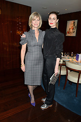 Left to right, NICOLA FORMBY and ERIN O'CONNOR at a dinner hosted by AA Gill & Nicola Formby in support of the Borne charity held at Rivea at the Bulgari Hotel, Knightsbridge, London on 3rd February 2015.