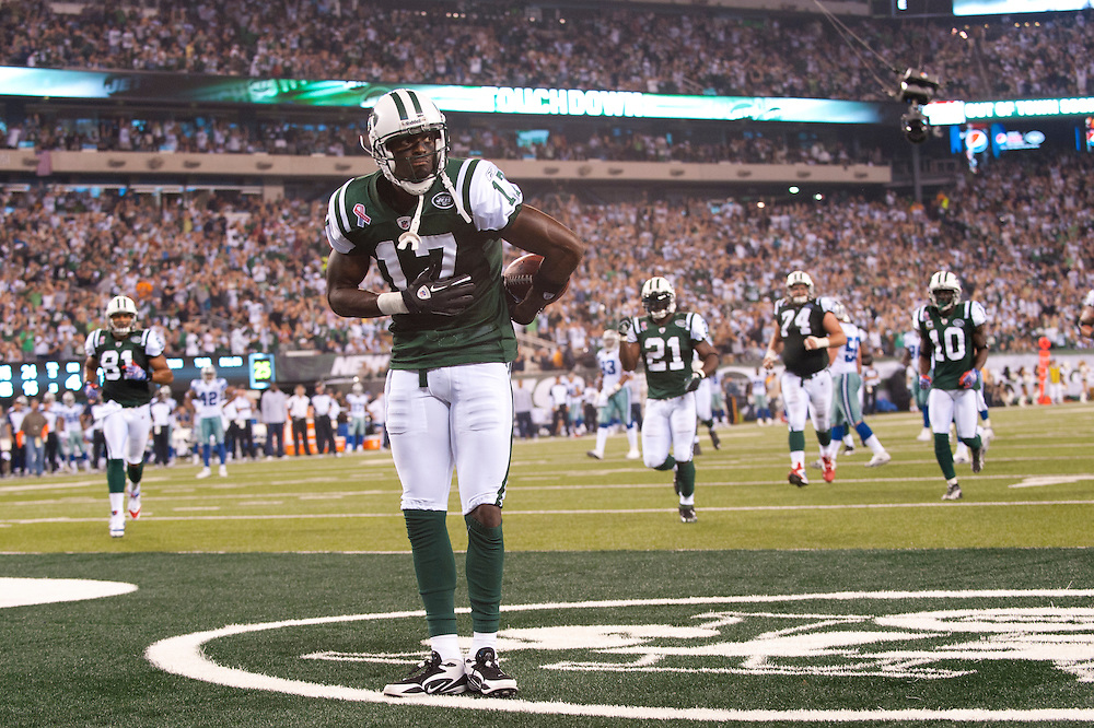 EAST RUTHERFORD, NJ - SEPTEMBER 11: Plaxico Burress #17 of the New York Jets reacts after scoring a touchdown against the Dallas Cowboys at MetLife Stadium on September 11, 2011 in East Rutherford, New Jersey. The Jets defeated the Cowboys 27 to 24. (Photo by Rob Tringali) *** Local Caption *** Plaxico Burress