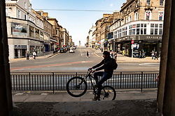 Pictured: At least one cyclist was enjoying the lack of footfall on the main shopping street in Edinburgh<br />