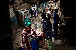 People walk the trash filled streets in Mathare, one of the poorest slums in Nairobi.  Running water and electricity are scarce and trash and human waste fill the streets.  Many people have no jobs and those who do work can earn less than one dollar a day.