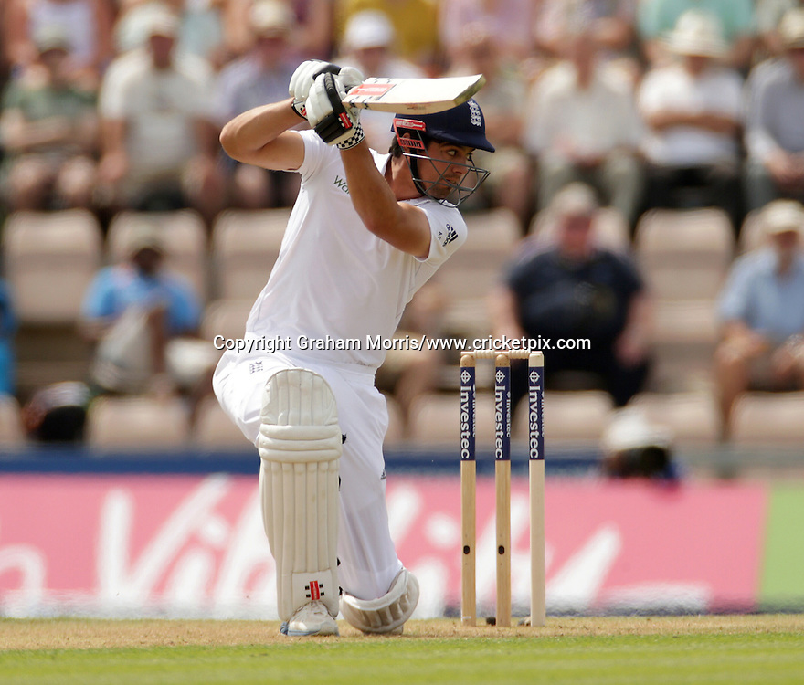 Alastair Cook drives Mohammed Shami for four during the third Investec Test Match between England and India at the Ageas Bowl, Southampton. Photo: Graham Morris/www.cricketpix.com (Tel: +44 (0)20 8969 4192; Email: graham@cricketpix.com) 27/07/14