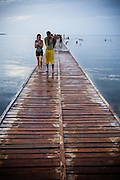 Couple walking down a wharf in Puerto Esperanza, Cuba on Wednesday August 6, 2008.