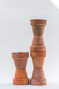 A recent series of photographs of small terra cotta flower pots, occassionally with a large stone.