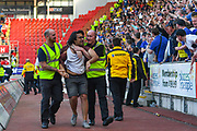 A Birmingham City fan is escorted out of the ground by stewards during the EFL Sky Bet Championship match between Rotherham United and Birmingham City at the AESSEAL New York Stadium, Rotherham, England on 22 April 2019.