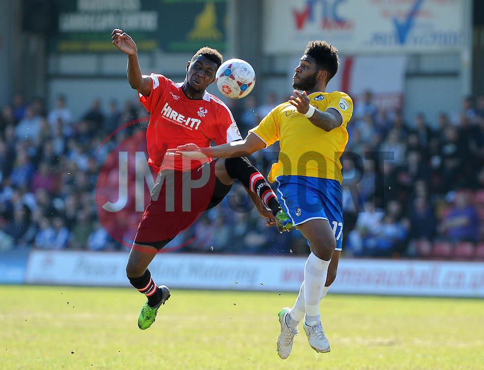 Bristol Rovers' Ellis Harrison challenges Kidderminster Harriers's Nat Kelly  - Photo mandatory by-line: Neil Brookman/JMP - Mobile: 07966 386802 - 06/04/2015 - SPORT - Football - Kidderminster - Aggborough - Kidderminster v Bristol Rovers - Vanarama Football Conference