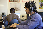 A prisoner working on a computer during one of his classes. HMP The Mount, Bovingdon, Hertfordshire