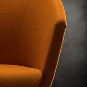 Detail view of orange, Artifort, Megan chair, studio shot.