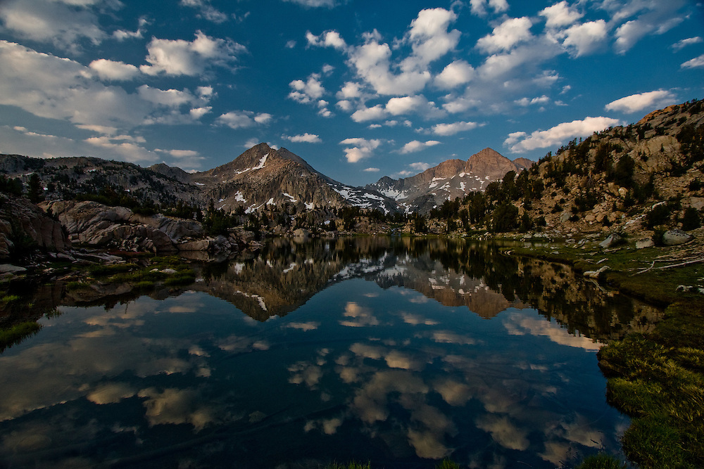 Clouds reflecting in the waters of Sixty Lakes Basin, Sierra Nevada of California