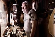 Praiano, Italia - Il liutaio Pasquale scala ritratto nel suo piccolo studio a Praiano. Pasquale realizza, con l'aiuto del figlio leonardo, pezzi unici: chitarre, mandolini, violini e strumenti della tradizione musicale napoletana.<br /> Ph. Roberto Salomone
