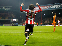 Brentford FC's Jota celebrates scoring his side's fourth goal during the Sky Bet Championship match between Brentford and Wolverhampton Wanderers at Griffin Park, London 29/11/2014 Picture by Mark D Fuller