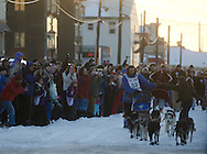 Iditarod fans on Front Street in Nome greet John Baker on Tuesday.