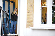 Lana Wrightman at her  front door and Edie, 2 and 1/2 at the window on 31 Groombridge Road, Hackney, London CREDIT: Vanessa Berberian for The Wall Street Journal<br /> HACKNEY-Lana Wrightman