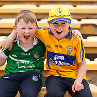 Cilian Tobin from Parteen and Jack Slattery from Broadford cheer on their favourite teams at Sundays Senior Hurling Quarter Final