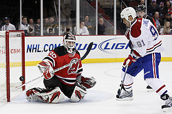 Dec 16, 2009; Newark, NJ, USA; New Jersey Devils goalie Martin Brodeur (30) makes a save on Montreal Canadiens center Scott Gomez (91) during the first period at the Prudential Center.