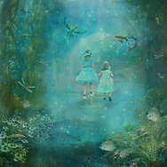 Two little girls on an enchanted walk in turquoise blue water under the sea