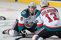 KELOWNA, CANADA - MARCH 23: Colten Martin #8 of the Kelowna Rockets stretches on the ice during warm up against the Tri-City Americans on March 23, 2014 at Prospera Place in Kelowna, British Columbia, Canada.   (Photo by Marissa Baecker/Shoot the Breeze)  *** Local Caption *** Coleten Martin;