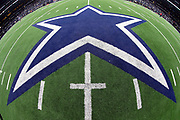 The Dallas Cowboys logo is painted on the field turf in this general view photograph taken from the mid-field 50 yard line area after the NFL week 13 regular season football game against the New Orleans Saints on Thursday, Nov. 29, 2018 in Arlington, Tex. The Cowboys won the game 13-10. (©Paul Anthony Spinelli)
