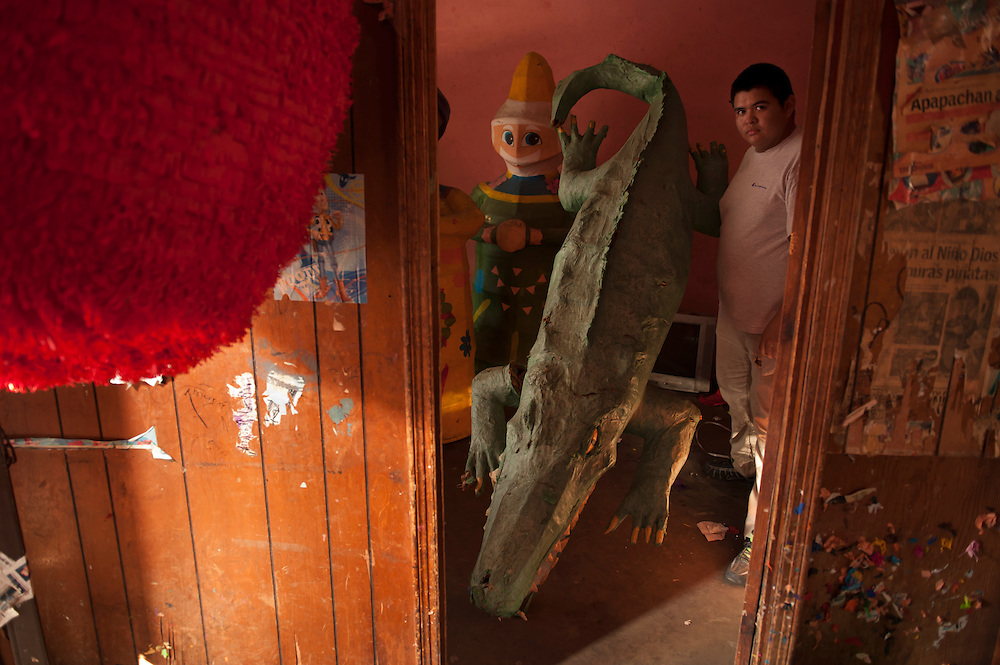 Luis Angel Cedillo Hernandez (Gladiador) is a piñata maker in Nuevo Laredo. He often builds piñatas just for fun like this large crocodile which is 'living' in the work shop and is not for sale. He is very proud of his business which he inherited from his father. There are several piñata makers in the area.
