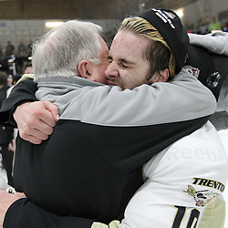 TRENTON, ON - Apr 22, 2016 -  Ontario Junior Hockey League game action between Trenton Golden Hawks and the Georgetown Raiders. Game 5 of the Buckland Cup Championship Series  at the Duncan Memorial Gardens in Trenton, Ontario. Trenton Golden Hawks John McDonald and Kevin Lavoie #10 of the Trenton Golden Hawks embrace after the Trenton Golden Hawks win the Buckland Cup.<br /> (Photo by Tim Bates / OJHL Images)