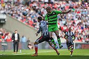 Forest Green's Charlie Clough out jumps Grimsby Town's Pádraig Amond during the Conference Premier Final match between Forest Green Rovers and Grimsby Town FC at Wembley Stadium, London, England on 15 May 2016. Photo by Shane Healey.