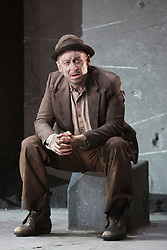 "© Licensed to London News Pictures. 05/06/2015. London, UK. Pictured: Richard Roxburgh as Estragon. Actors Richard Roxburgh and Hugo Weaving star in Samuel Beckett's ""Waiting for Godot"" at the Barbican Theatre. Part of the International Beckett Season, this Sydney Theatre Company play is directed by Andrew Upton. With Luke Mullins as Luke, Philip Quast as Pozzo, Richard Roxburgh as Estragon and Hugo Weaving as Vladimir. Performances from 4 to 13 June 2015 at the Barbican Theatre. Photo credit : Bettina Strenske/LNP"