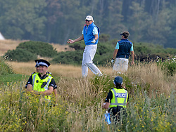 Pictured: Golfers seem bemused by the protests.<br /> <br /> Protesters gathered amid tight security at the Trump Turnberry resort, where President Trump and his wife Melania are staying on their trip to Scotland.<br /> <br /> © Dave Johnston / EEm