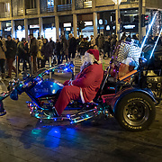 BUDAPEST, HUNGARY - DECEMBER 07:  A man dressed as Father Christmas poses for a picture in the city centre on December 7, 2017 in Budapest, Hungary. The traditional Christmas market and lights will stay until 31st December 2017.