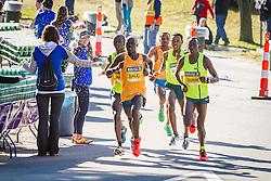 Boston Athletic Association Half Marathon, lead pack of elite men at water station at 11 miles, led by Salel, Korir, Sambu, Desisa chase