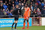 Shrewsbury Town defender Aristote Nsiala (22) is shown a yellow card, booked  during the EFL Sky Bet League 1 match between Scunthorpe United and Shrewsbury Town at Glanford Park, Scunthorpe, England on 17 March 2018. Picture by Mick Atkins.