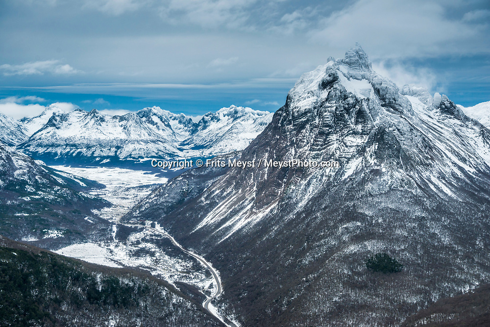 Ushuaia, Tierra del Fuego, Argentina, June 2017. During a helicopter flight we see the Beagle Channel, Martial Glacier, Mount 5 Hermanos, the emblematic Mount Olivia and the city of Ushuaia, framed by the imposing Andes Mountains. Taking a boat excursion in the Beagle Channel we are greeted greeted by humpback whales, sea lions, condors and gentoo penguins agains a wild mountainous backdrop with spectacular skies. The trip includes lunch in an old sheep farmer's shack and a hike on Gable Island. Photo by Frits Meyst / MeystPhoto.com