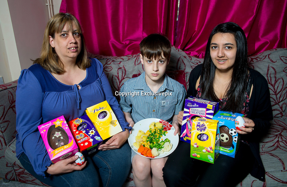 "'EASTER EGGS COULD BRAIN DAMAGE MY SON!'<br /> <br /> LITTLE Ozy Baker is the only one of his friends who is NOT counting the number of chocolate eggs he's been given in the run up to Easter Sunday.<br /> <br /> In fact, nine-year-old Ozy wouldn't know his Mars bar from his Milky Way.<br /> <br /> For the chirpy schoolboy has never been allowed to eat chocolate his entire life - because, if he does, it may cause him brain damage!<br /> <br /> Ozy was born with a rare protein intolerance, which means if he were to eat chocolate, or many other types of food most of us enjoy every day, he would suffer irreparable brain damage.<br /> <br /> Easter is a particularly hard time of year for Ozy with shelves stacked to the rafters with every kind of Easter egg and chocolate figurines imaginable.<br /> <br /> Mum Safia, 44, says: ""Ozy's main diet is fruit and veg - every day is a challenge for him - but Easter is especially difficult because there's all this chocolate being enjoyed around him.<br /> <br /> ""In the past he's got a little teary and asked, 'What does real chocolate taste like?'  It's heartbreaking as there's no days off with this condition. And Easter  is no exception.<br /> <br /> ""He's never registered the different types of chocolate like Kitkats or Mars bars, as he's never tried them.<br /> <br /> ""At Easter he sees a lot a Disney eggs and TV character eggs which he gets excited about until he remembers he cannot have them.<br /> <br /> ""I try to buy Easter eggs that have cups or toys in them of his choice. The chocolate then goes to his dad and sister and he keeps the novelty.<br /> <br /> MORE...<br /> <br /> When Ozy was just seven-years-old, mum Safia sat him down in front of the computer and clicked onto a YouTube site.<br /> <br /> But the images which filled the screen were not kiddies' cartoons - but real-life images of adults with severe brain damage.<br /> <br /> This may seem extreme, but for mum Safia it was the only way she felt she could guarantee her own beloved son did not end up like the people in the film.<br /> <br /> ""It sounds an incredibly harsh thing to do, but I would rather him know what could happen to"