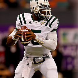 December 18, 2010; New Orleans, LA, USA; Ohio Bobcats quarterback Phil Bates (5) looks to pass during against the Troy Trojans the first half of the 2010 New Orleans Bowl at the Louisiana Superdome.  Mandatory Credit: Derick E. Hingle