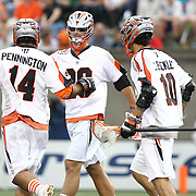 Lee Zink #29 of the Denver Outlaws celebrates with teammates Justin Pennington #14 of the Denver Outlaws and Chris Bocklet #10 of the Denver Outlaws during the game at Harvard Stadium on May 10, 2014 in Boston, Massachusetts. (Photo by Elan Kawesch)