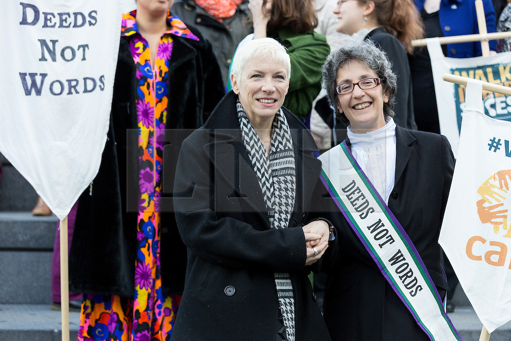 """© Licensed to London News Pictures. 08/03/2015. London, UK. Annie Lennox with Helen Pankhurst at the """"Walk In Her Shoes"""" event to mark International Women's Day at The Scoop amphitheatre on the south bank in London. Photo credit : Vickie Flores/LNP"""