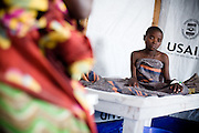A girl suffering from cholera sits on her bed at the Virunga cholera treament center in Goma, Eastern Democratic of Congo on Monday December 15, 2008. Mungwiko is the second of eight siblings to be infected with cholera. With the recent displacement of over 300,000 people in DRC's North Kivu province, thousands of people are living in close proximity, in IDP camps or in host families, increasing the stress on already scarce water supply networks and increasing the transmission rate of infectious diseases such as cholera.